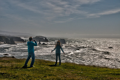 Young couple taking pictures at Bandon.