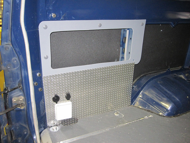 rear power panel and rear storage, LH side.