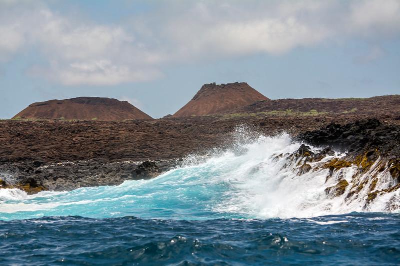 Waves crashing against lava rock