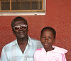 Grandfather and grandson outside post office in Banjul, The Gambia.