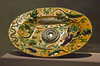 """Oval Basin - about 1550<br /> attributed to Bernard Palissy - French<br /> Lead glazed earthenware<br /> Palissy developed his distinctive """"rustic-ware"""" by making casts from actual shells, plants, and reptiles. He then attached them to ceramic forms that he decorated with runny, lead-based glazes."""