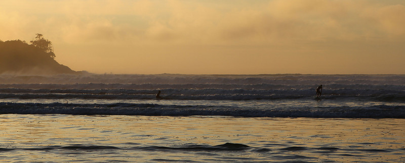 The surf was up and crashing joyously!  Can you spot the surfers?