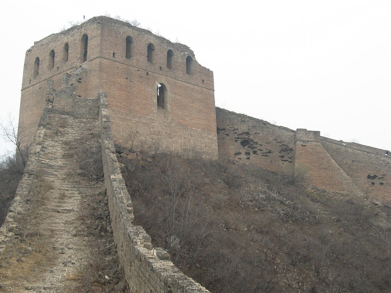 A steep and rocky climb up to a large watchtower.
