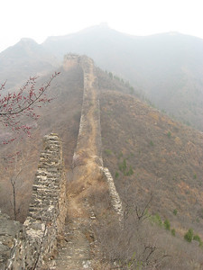Standing on the Gubeikou section of the Great Wall of China.  It has not been restored so you get what you get.  Time to start hiking!