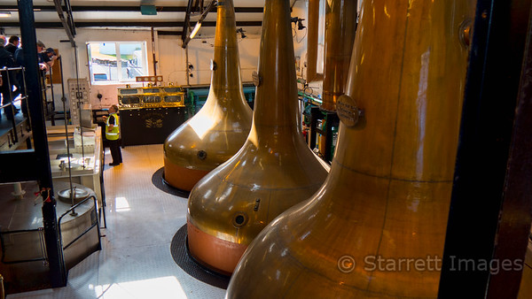 Copper stills at Bowmore Distillery, Port Charlotte, Islay.