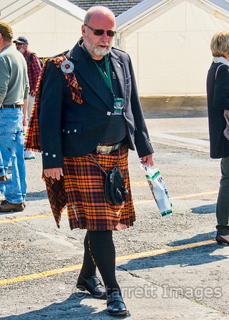 "Formal Scots attire seen at the Laphroaig Distillery outside of Port Ellen, Islay.  Note the green strap with a wee Laphroaig glass.  They let us each have two ""wee drams"", a quaint Scots whisky measure.  On our vessel, they also offered a wee dram with our porridge in the morning."