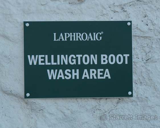 You do see peculiar signs in the UK.  They mean rubber rain boots.