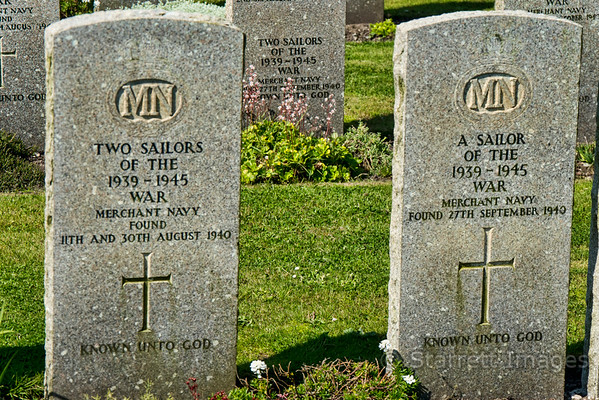 Unknowns, pulled from the sea during the war.  Brits?  American?  These were at the round church in Port Charlotte on Islay.