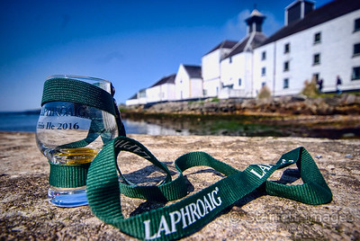 "This shot of the Laprroaig Distillery shows the ""wee dram"" glasses they gave us.  Our fellow passenger,  Ken Scott, took the picture, I think a very creative image of Laphroaig .  Used with Ken's permission."