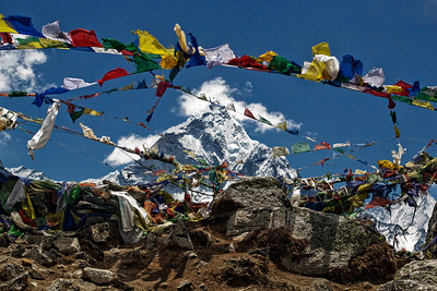 Taboche (6367m elevation) peak, as seen through the myriads of Prayer Flags at the Stone Memorials above Dughla.