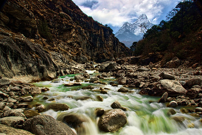 Ama Dablam (6856m elevation) towers over the valley carved by Dudh Koshi River