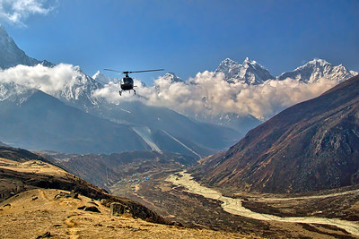Rescue/Supply choppers flew past us at close quarters...  The tiny village of Pheriche can be seen in the valley below.