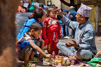 A family gets their teekas done at Swayambhunath Stupa, Kathmandu