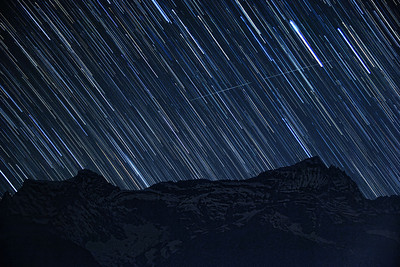 Star trails at night against Kongde Ri peak in the background