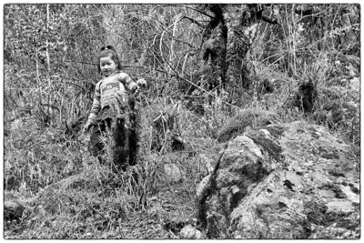A kid looks down on me, while playing hide-n-seek in the jungle, at Nurning Ghat