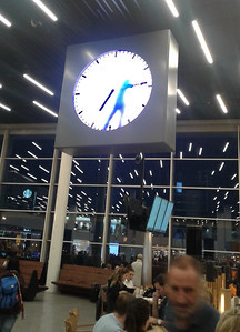 Amsterdam airport. This is a clock and the man inside moves the arms.