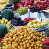 Colorful fresh fruit for sale from a street vendor.