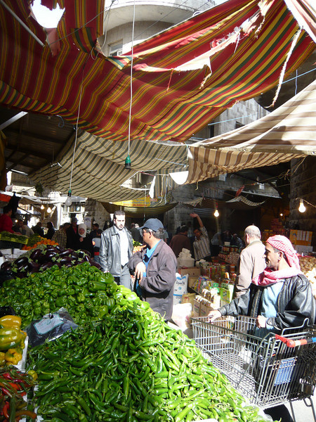 A full size shopping cart in the vegetable market means serious shopping.