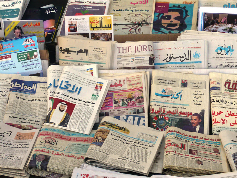 Newspapers at a local news kiosk.