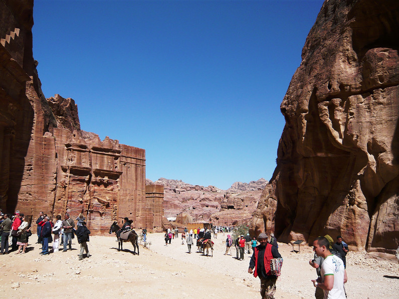 A line of tombs on the left side along the Street of Facades in Petra.