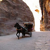 A horse drawn carriage ferrying visitors through the Siq to the Treasury.