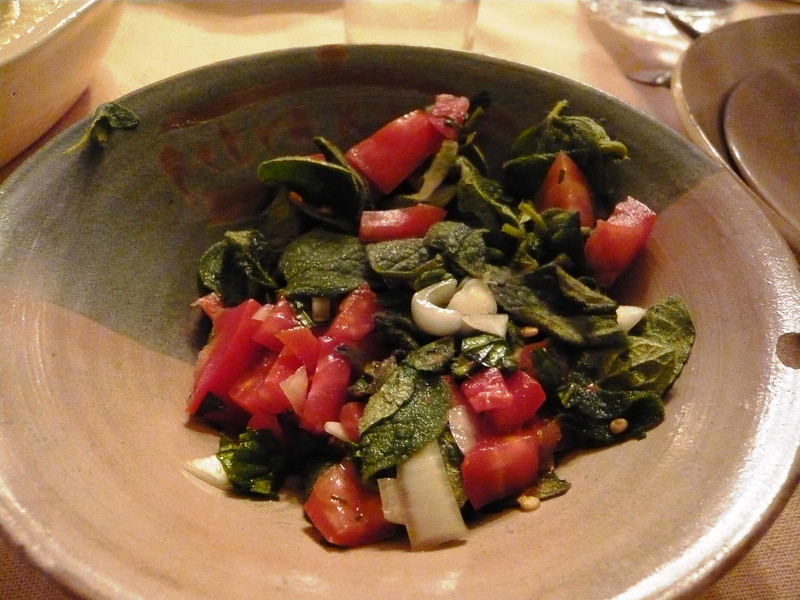 Salad of tomato, onion, and broad leaf thyme.
