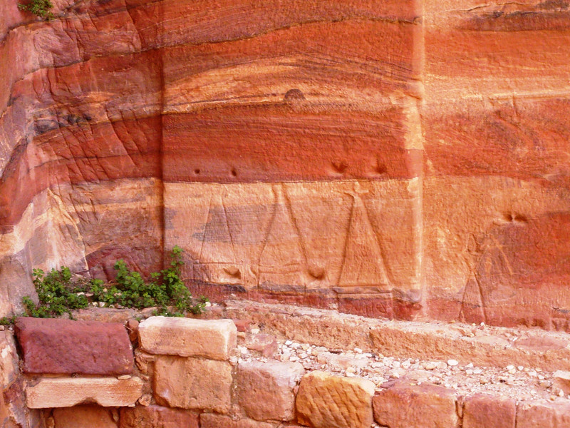 Note the figures carved into the bottom section of the wall. The small one on the right appears to be a child.