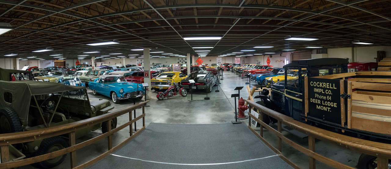 lots of cars in the museum