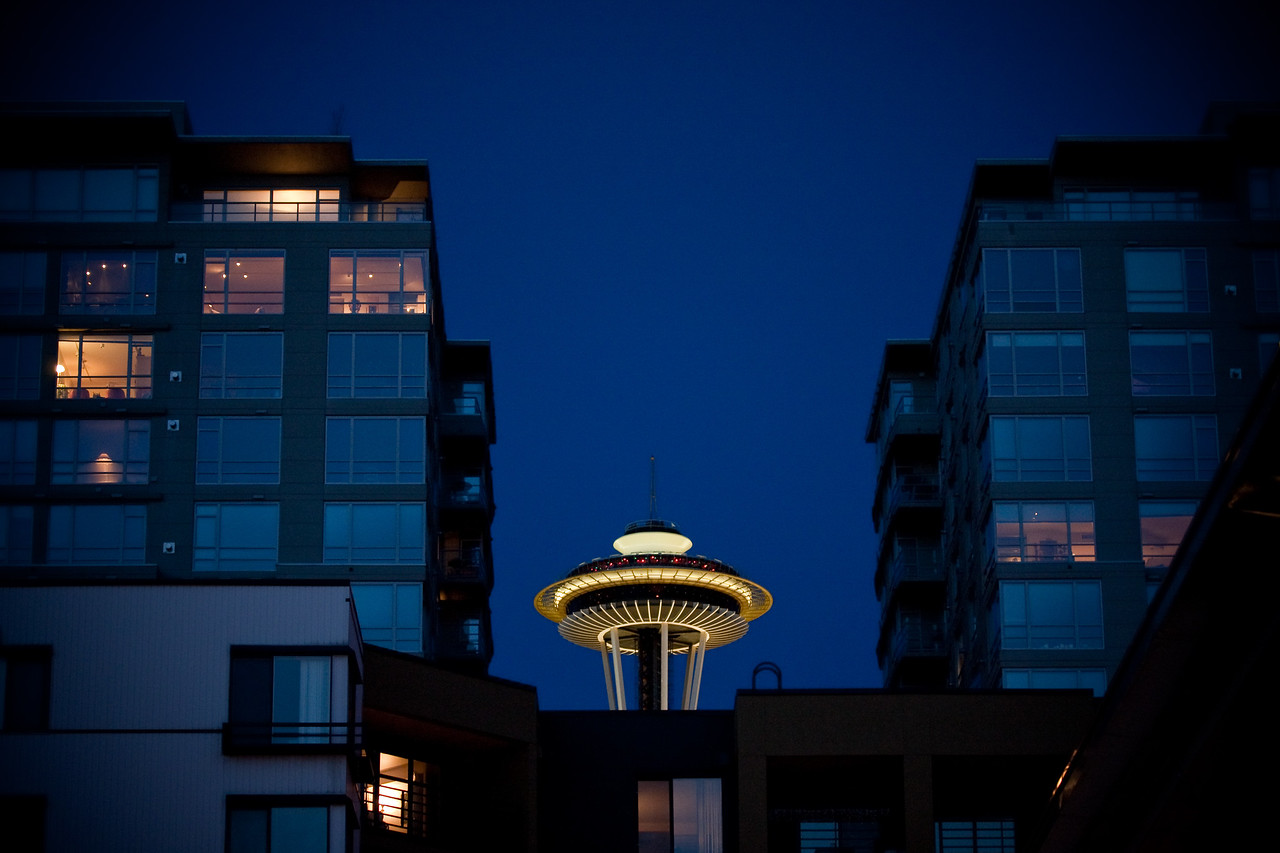 The Space Needle, seen from the Olympic Sculpture Park, peeking out from behind some apartments