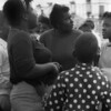 """On a weekend trip, we visit a country fair near Mobile Alabama. I take this image of local folks at a carnival while in the Naval School of Photography. I never get around to printing this picture until we are stationed in Washington. There, the photo is received most poorly by the many black people working at DIA's photo lab. """"Damn,"""" one of the civilian lab technicians says on seeing the print. """"Ya'all gonna say something bout black folks, why not say something nice?"""" I see the people in the image as beautiful representations of who they are,  but from then on consider some see a different statement."""