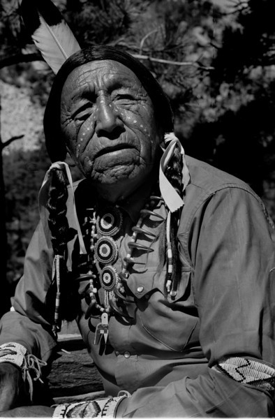 "This is Ben Black Elk. This is where the photographic story starts in the summer of my 18th year. Native Americans say we reach an age when we would gladly trade the rest of our life for a single summer in our youth. Should that time come, I'll take the summer of 1965 when Lenny Kaczor walked off to look for America, and discovered old Ben. This photo of Ben gets me my first newspaper photography job in 1966 but the job costs me my student draft deferment. But the photography experience makes me a Navy photographer.<br /> <br /> Even if one only gets a moment in life to repeat, I'll take that instant of epiphany, under the dark cloth, when the old Sioux prophet came to focus on the ground glass of my antique press camera. So compelling is the surging current in my soul, only my tripod keeps shaking hands from blurring this image of Black Elk. <br /> <br /> Young and foolish, I think I've discovered an old Indian in full Sioux regalia who happened to be sitting around Mount Rushmore National Monument. Instead, Black Elk, discovers me. I don't know then Ben is considered America's most photographed Native American in history.  I take my photographs and he calls me to sit with him. <br /> <br /> He tells me the story of the first photographer he had ever seen when he was a young man, like me. ""The man had a camera just like yours,"" says Ben gestering to my rare 3 1/4 X 4 1/4 press camera, ""The photographer scared my people with his magic because we felt he captured our spirits with his strange black box."" Ben goes on to explain that time, education, and understanding has taught him differently. Yet part of him can't shake his original belief that cameras steal a bit of our souls. <br /> <br /> From that conversation forth, I know I'm a photographer. I go off into the world with a new understanding of my place in the grand scheme of  things. I take a piece of Black Elk's force with me, and live the life of a spirit catcher."