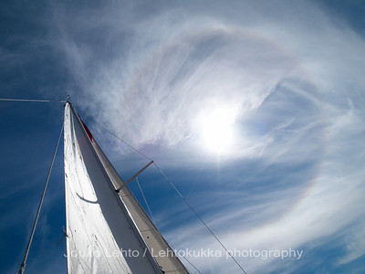 Halo over sails. Perämeri, in front of Kemi