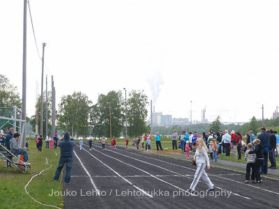 Field and Tracks - Paavonkari sports field in Kemi. Stora Enso Veitsiluoto paper mill in the back.