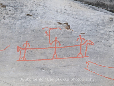 Rock carvings - warship or fishermen? : painted over for easier observation