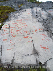 Rock carvings -  deers, a hunterman, shaman (man), net etc, : painted over for easier observation