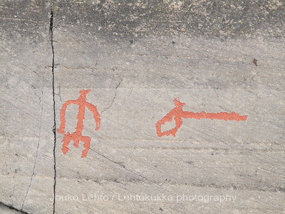 Rock carvings - shaman and  a symbol: painted over for easier observation