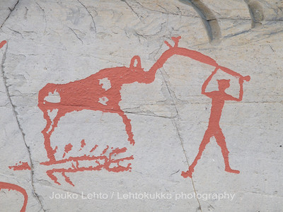 Rock carvings -  deer and female hunter etc, : painted over for easier observation