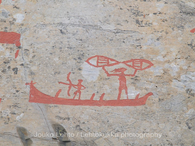 Rock carvings -  a boat, hunterman, fisher (female?) with a net : painted over for easier observation