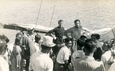 "Arrival; looking tired.  Canvas sails furled. Dad;s caption reads, ""Alongside, 28 days out of Auckland"".  Ted in dark shirt with Dad."