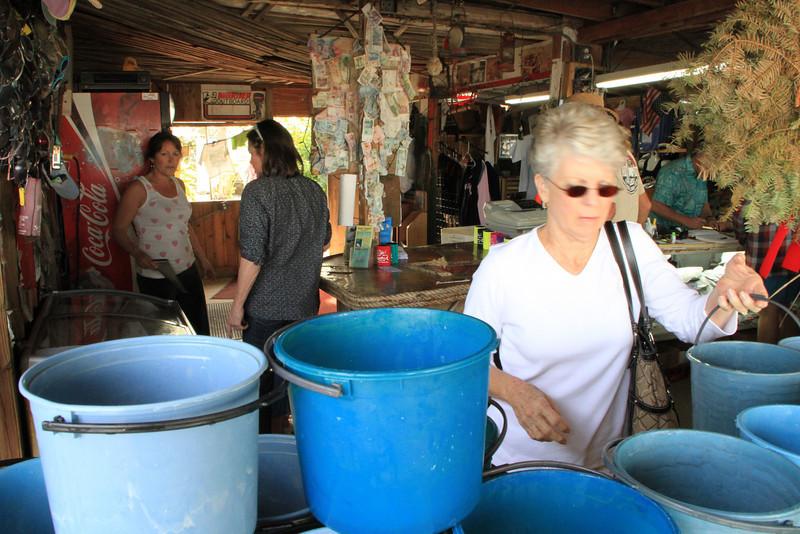 Lynda getting her bucket of fish to feed the tarpon.