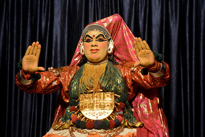 Mudra Kathakali Centre, Thekkady. Kathakali, literally meaning `story-play', is a dance-drama originated in the 17th century in Kerala, one of the smallest states in India lying on the west coast of the Indian peninsula. Kathakali is the result of a fusion between all Indian theater tradition represented by Koodiyattom and the indigenous tradition of folk dance forms. It was one of the Rajas (Chieftain) of Kottarakkara, who wrote the first play intended for Kathakali performance. They form a cycle of eight stories based on Ramayana. Stories typically deal with the Mahabharata, Ramayana and the ancient scriptures known as the Puranas. This is performed in a text which is generally Sanskritised Malayalam.  Thekkady (Idukki district) in Kerala is the location of the Periyar National Park, which is an important tourist attraction in India.