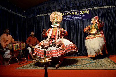The story is about Lalitha, a maiden slave to Demon King Narakasura who was told to leave for heaven to kidnap the handsome green face Jayantha, son of Lord Indra. She changed her demonic look and disguised as beautiful Lalitha to befriend Jayantha and to entice him to marry. Trying her very best by dance and seduction this handsome hero does not fall for it leading Jayantha to reveal her true identity, but she kept seducing him with lustful desire. Jayantha told her he will never marry anyone without his father's consent. Jayantha became very angry and told her to leave the palace. She told Jayantha she is here to kidnap him and tried to catch hold of Jayantha. She went berserk and let loose her hair in agitation. Jayantha became very very very furious, he drew out his sword and cuts off her ears, nose and breast leaving her screaming in pain and returned to Narakasura. At the end of the performance Jayantha danced in lordly character and then left the palace to inform his father about the incident.  Mudra Kathakali Centre, Thekkady. Kathakali, literally meaning `story-play', is a dance-drama originated in the 17th century in Kerala, one of the smallest states in India lying on the west coast of the Indian peninsula. Kathakali is the result of a fusion between all Indian theater tradition represented by Koodiyattom and the indigenous tradition of folk dance forms. It was one of the Rajas (Chieftain) of Kottarakkara, who wrote the first play intended for Kathakali performance. They form a cycle of eight stories based on Ramayana. Stories typically deal with the Mahabharata, Ramayana and the ancient scriptures known as the Puranas. This is performed in a text which is generally Sanskritised Malayalam. Thekkady (Idukki district) in Kerala is the location of the Periyar National Park, which is an important tourist attraction in India.