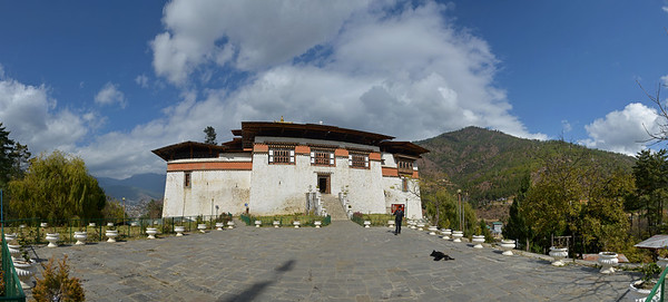Panoramic view of Semtokha Dzong, Semtokha, Thimphu, Bhutan.  Simtokha Dzong is a small dzong located about 3 miles south of the Bhutanese capital of Thimphu. Built in 1629 by Ngawang Namgyal, who unified Bhutan, the dzong is the first of its kind built in Bhutan and was recently renovated. It used to house Dzongkha language learning institutes.
