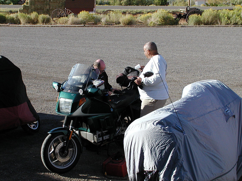 Brain trust planning the day's ride.  Tom and George.