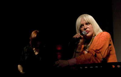 Genesis P-Orridge, Cosey Fanni Tutti in the background.