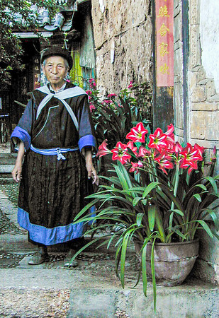 Naxi woman in her home in Lijiang, Yunnan Province, China. Believe she was 84 at this time.