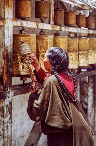 Pilgrim with prayer wheels, Joking Monastery, Lhasa, Tibet.