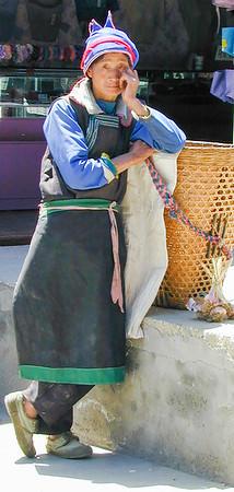 Naxi woman in Lijiang, Yunnan Province, China.