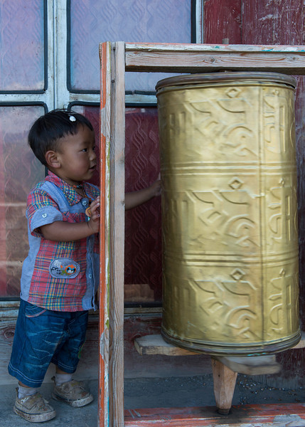 Droma Tsering spinning a mani or prayer wheel