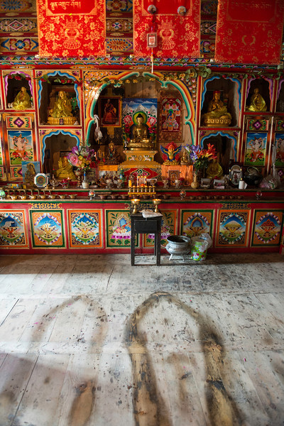 Shrine room in a Tibetan house.  The stains on the floor are from many prostrations, one of the foundation practices in Tibetan Vajrayana Buddhism
